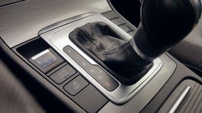 The man`s hand in close-up switches the transmission of an automatic gearbox. Parking, drive, reverse. The man`s hand in close-up switches the transmission of stock footage