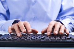 Keyboard and hand. Man's hand on computer keyboard woman's hand on the keyboard typing Royalty Free Stock Image