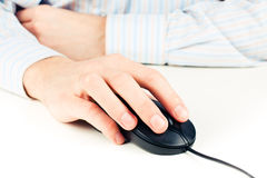 Man's hand on computer mouse Stock Images