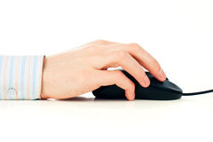Man's hand on computer mouse Royalty Free Stock Photography