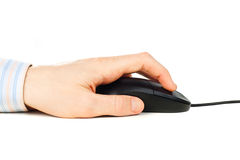 Man's hand on computer mouse Royalty Free Stock Image