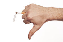 Man S Hand Crushing Cigarette Royalty Free Stock Photography