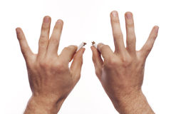 Man's hand crushing cigarettes Royalty Free Stock Image