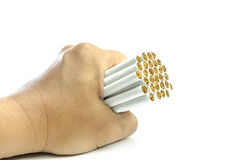 Man's hand crushing cigarettes stop smoking Royalty Free Stock Images