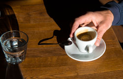 Man's hand a with cup of  coffee Stock Photos