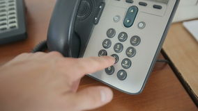 Man`s hand is dialing a phone number stock footage