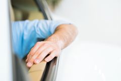 Man's hand is on the door of the car Royalty Free Stock Photo