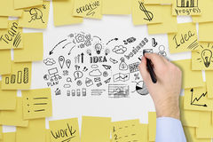 Man`s hand drawing business icons on whiteboard Stock Photography