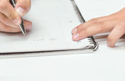 Mans hand drawing in a notebook. Mans  right hand drawing in a notebook Royalty Free Stock Image