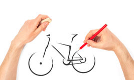Man's Hand draws a bicycle Royalty Free Stock Images
