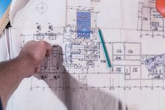A man`s hand draws a construction drawing. Working man Stock Photography