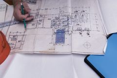 A man`s hand draws a construction drawing. Working man Royalty Free Stock Image