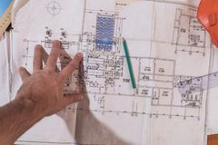A man`s hand draws a construction drawing. Working man Stock Image