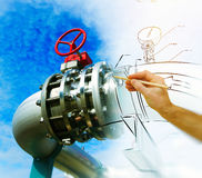 Man`s hand draws a design of factory Stock Photo