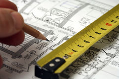 Man's hand draws a pencil business plan. Draft, with ruler Royalty Free Stock Images