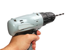 Man's hand with a drill on a white. Background stock photography
