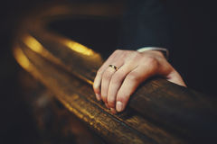 Man's hand with an engagement ring holds old wooden list Stock Photos