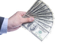 Man's Hand With a Fan Of Dollars Stock Images