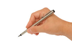 Man's hand with a feather pen Stock Image