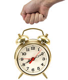 Man's hand in a fist about to hit a red clock Stock Images