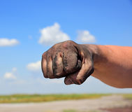 The man`s hand is fisted. Close up Royalty Free Stock Photography