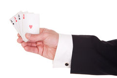 Man's hand with four aces Stock Photo