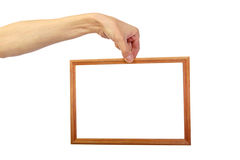 Man's hand with frame Royalty Free Stock Image