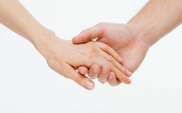 Man's hand gently holding woman's hand Stock Photos