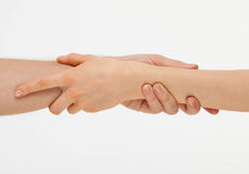 Man's hand gently holding woman's hand Royalty Free Stock Photography
