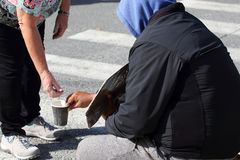 Man`s hand gives alms to the poor man. The man`s hand gives alms to the poor man stock images