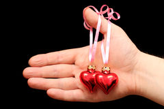 Man's hand gives hearts Royalty Free Stock Image