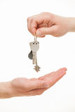 Man's hand giving a bunch of keys Royalty Free Stock Images
