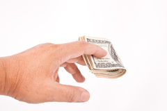 Man's hand giving dollars. Isolated on white Stock Photos