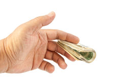 Man's hand giving dollars Stock Photo