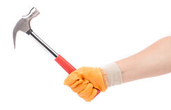 Man's hand in glove holding hammer. Royalty Free Stock Photo