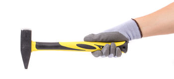 Man's hand in glove holding hammer. Royalty Free Stock Photography