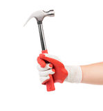 Man's hand in glove holds hammer. Royalty Free Stock Photo