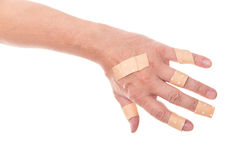 Man´s hand glued a lot of medical plaster on the elbow, isolate Stock Photos