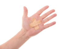 Man´s hand glued medical plaster on the elbow, isolated on whit Royalty Free Stock Photo