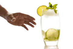 The man's hand grabs the cocktails. Stock Images