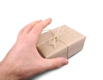 Man's hand grabs package, isolated. And close up stock photos