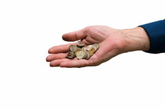 Man's hand with a handful of coins from a small metal-esteem. Embodies low standard of living, poverty Stock Photography