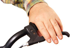 Man's hand on the handlebars. Royalty Free Stock Photography