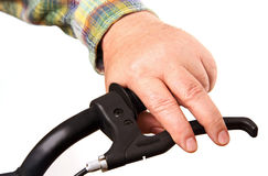 Man's hand on the handlebars. Royalty Free Stock Photos