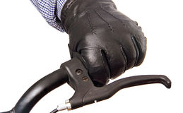 Man's hand on the handlebars. Stock Photo