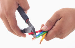 Man's hand hold cutter to strip electrical wire Stock Image
