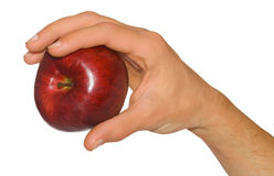 Man's hand holding an apple Stock Photos