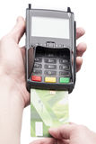 Man's hand holding a bank card on POS-terminal. Over white Stock Photography