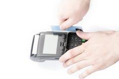 Man's hand holding a bank card on POS-terminal. Over white Stock Photos