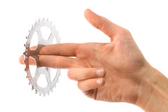 Man's hand holding a bike cog Stock Photography